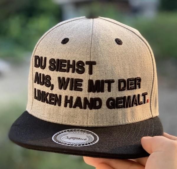 Snapback Cap DU SIEHST AUS WIE MIT DER LINKEN HAND GEMALT, grau/schwarz