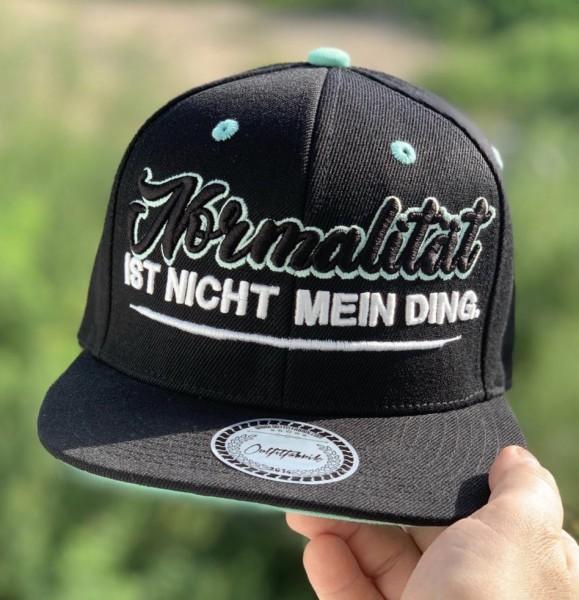 Snapback Cap NORMALITÄT IST NICHT MEIN DING, schwarz/mint